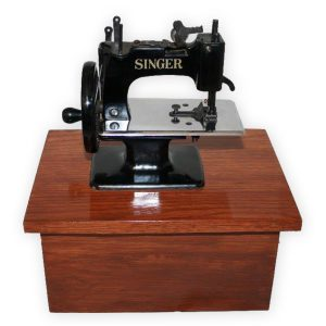 Small sewing machine urn