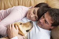 During times of stress, dogs love to be in an area that they know well, and preferably as close to you as possible.